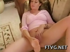chick plays with dildos